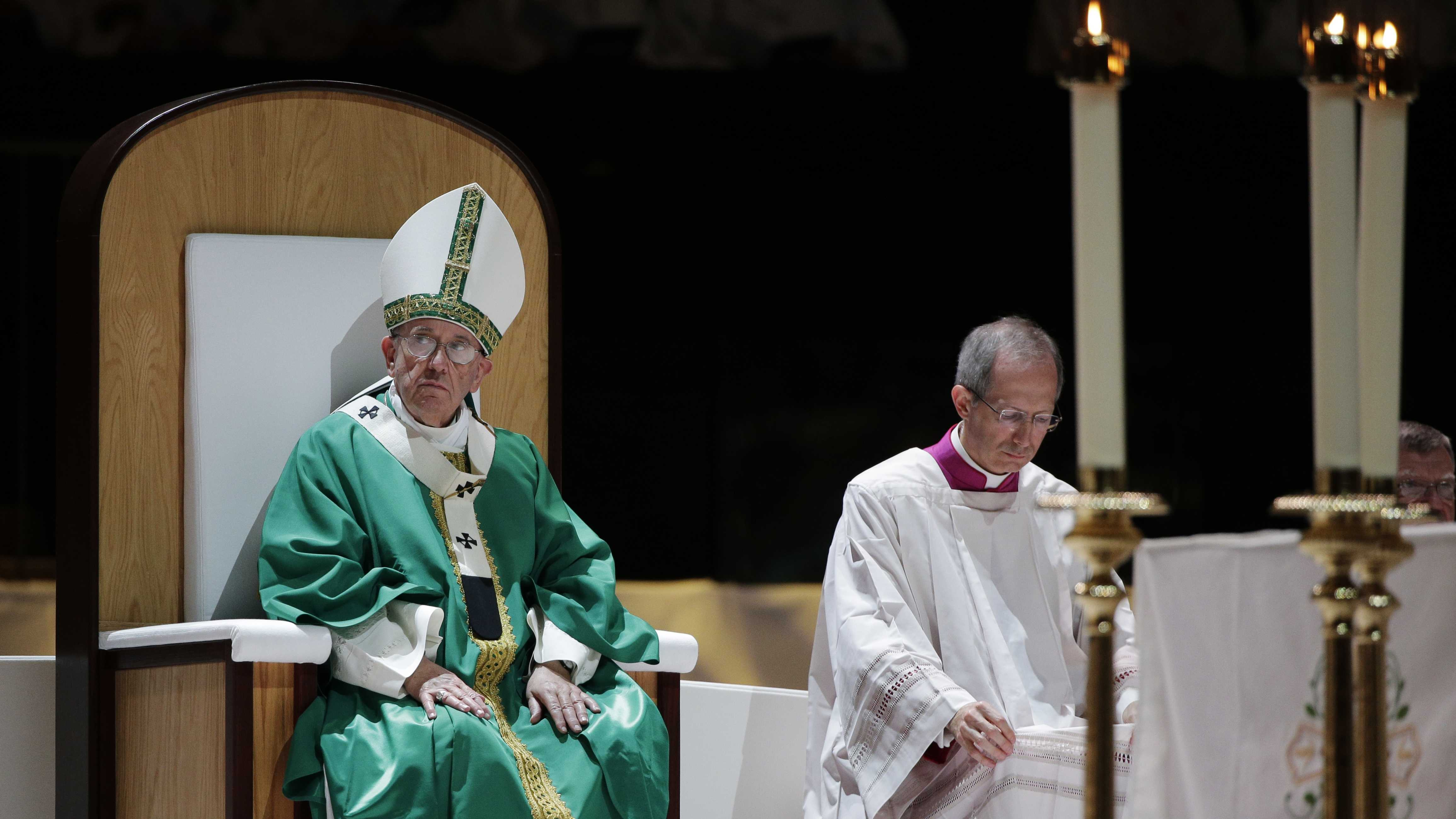 Pope Francis listens to the readings while celebrating Mass at Madison Square Garden, Friday, Sept. 25, 2015, in New York. (AP Photo/Julie Jacobson, Pool)