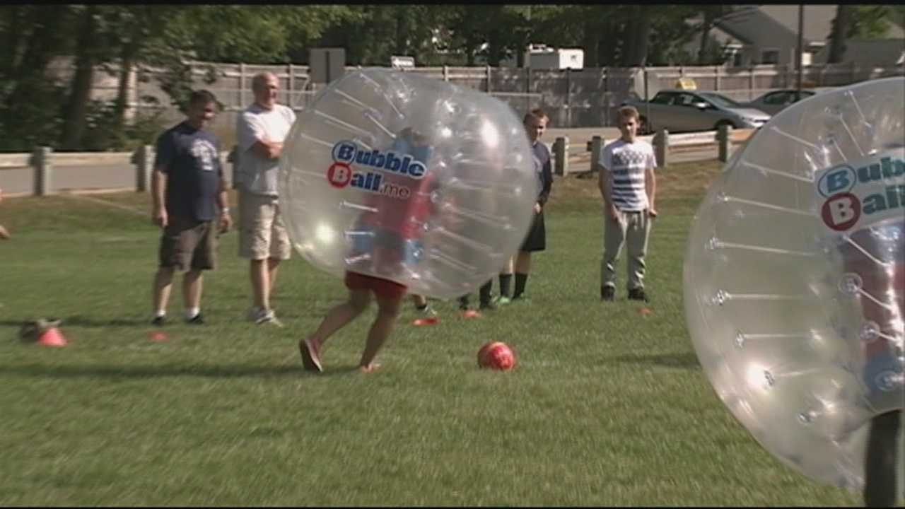 Watch out for the bubble boys! Students and teachers played a game of soccer in bubble suits at Milford High School Saturday.