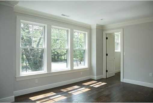 A large mudroom w/half bath & large pantry is off the three car heated garage.