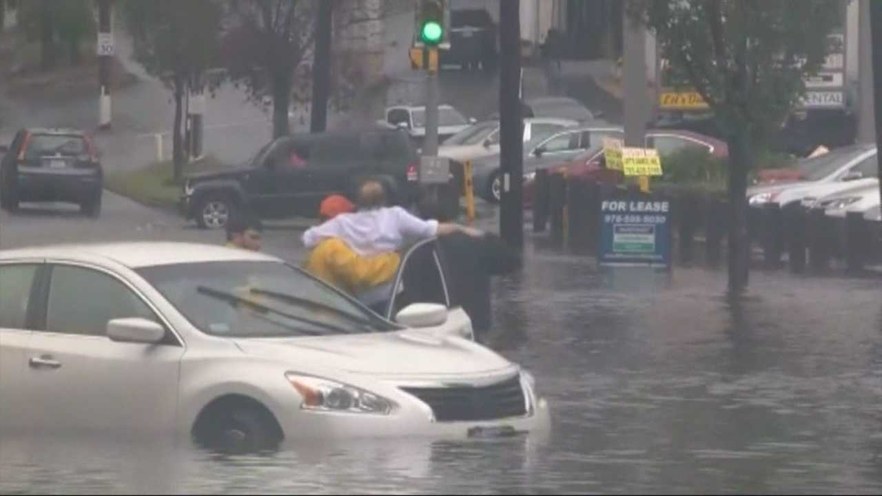 A woman was rescued from this flooded car in Stoneham.