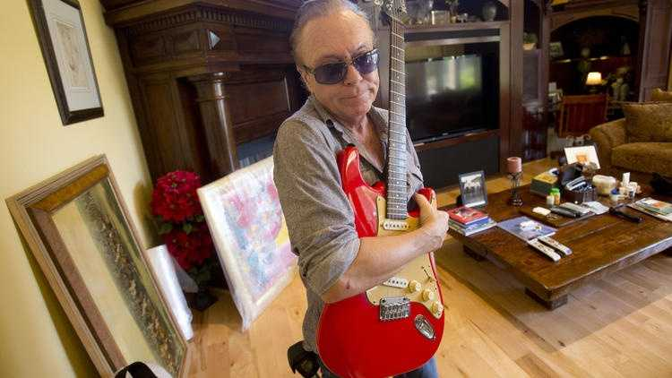 David Cassidy, pictured here in July 2015, poses with a favorite guitar as he gives a tour of his five-bedroom Fort Lauderdale mansion prior to its auction.