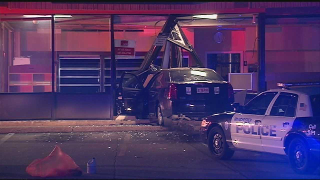 Manchester police are searching for a driver who crashed a car into a former Dunkin' Donuts on Main Street and then fled the scene.