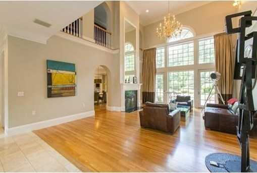 Immensely comfortable layout with two wings on the upper level connected by a gallery hallway with room for art and furniture.