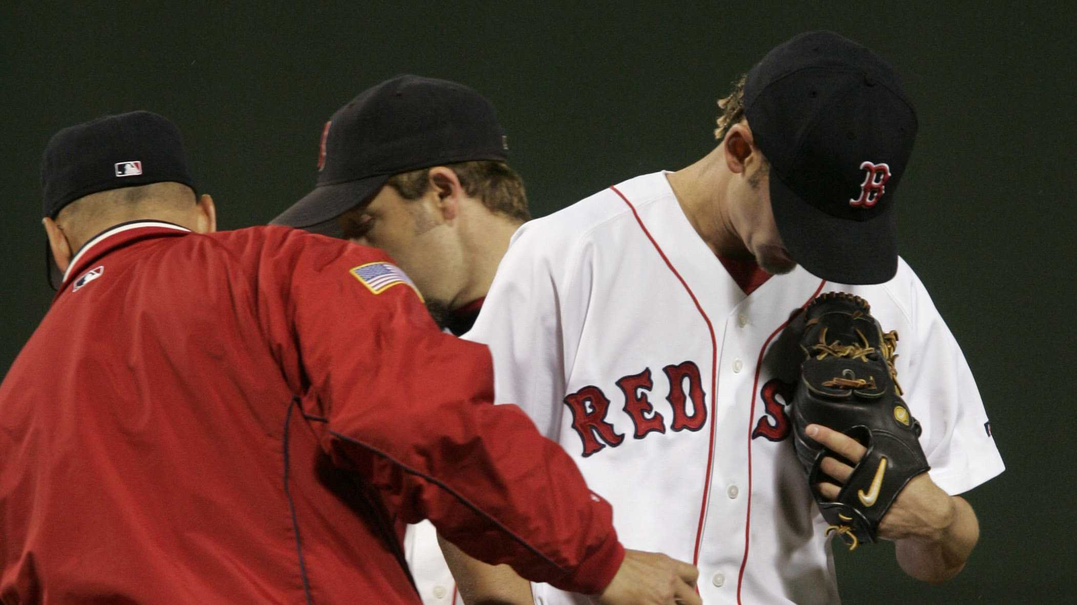 Boston Red Sox starter Bronson Arroyo, right, walks off the mound after being pulled from the game in the third inning by manager Terry Francona, left, at Boston's Fenway Park in game three of the ALCS with the New York Yankees, Saturday Oct. 16, 2004.