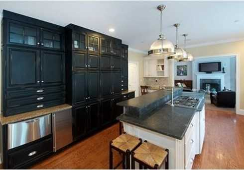 A gourmet kitchen with a breakfast room and adjoining family room.