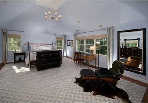 There are 6 en suite bedrooms upstairs highlighted by a luxurious master suite with office and marble master bath.