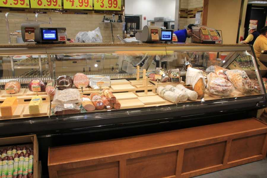 The deli bar features regular and organic meats. Another area features popular pre-sliced meats.