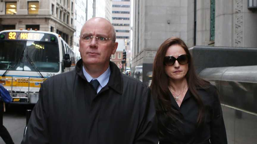 Former Anglo Irish Bank chief David Drumm, left, and his wife Lorriane leave the U.S. Bankruptcy Courthouse where Drumm's bancraptcy trial is ongoing on Wednesday May 28, 2014, in Boston.