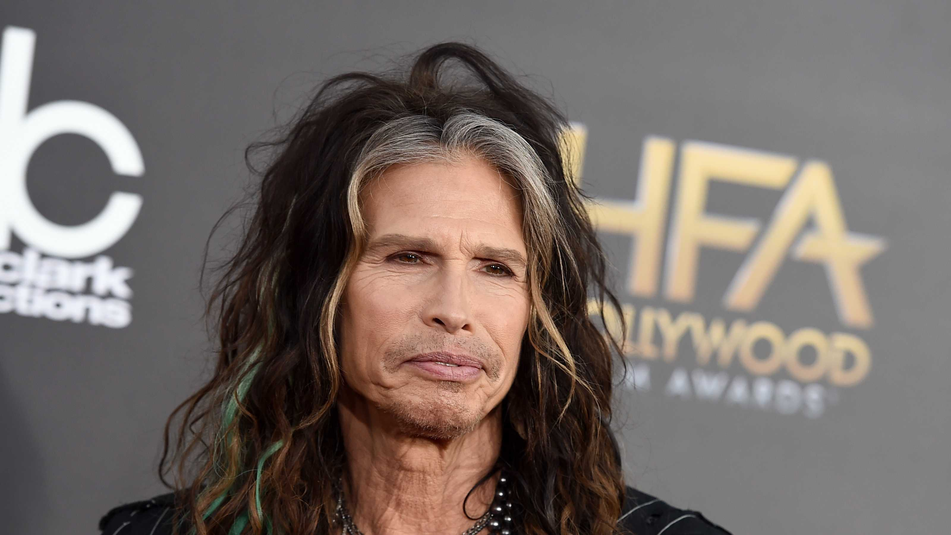 """Steven Tyler arrives at the Hollywood Film Awards at the Palladium, in Los Angeles. Aerosmith frontman Tyler is asking Republican presidential candidate Donald Trump to stop using the power ballad """"Dream On"""" at campaign events."""