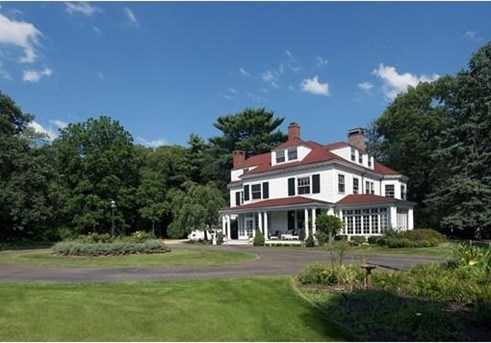 This stunning Colonial Revival is set on over three picturesque acres in the center of town.