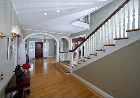 The features in this grand and elegant home include a stunning entryway with a fireplace, wood paneled library, an expansive living room that opens to a sun room over looking the property, a stately dining room with access to the patio, beautiful architectural details, and gracious room sizes.