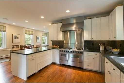 A custom granite kitchen with upscale appliances.