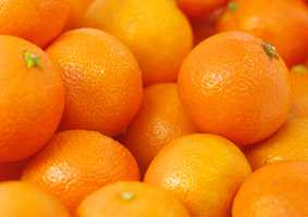 Too many oranges can wear away at tooth enamel, but in moderation the citrus acid will brighten your smile.