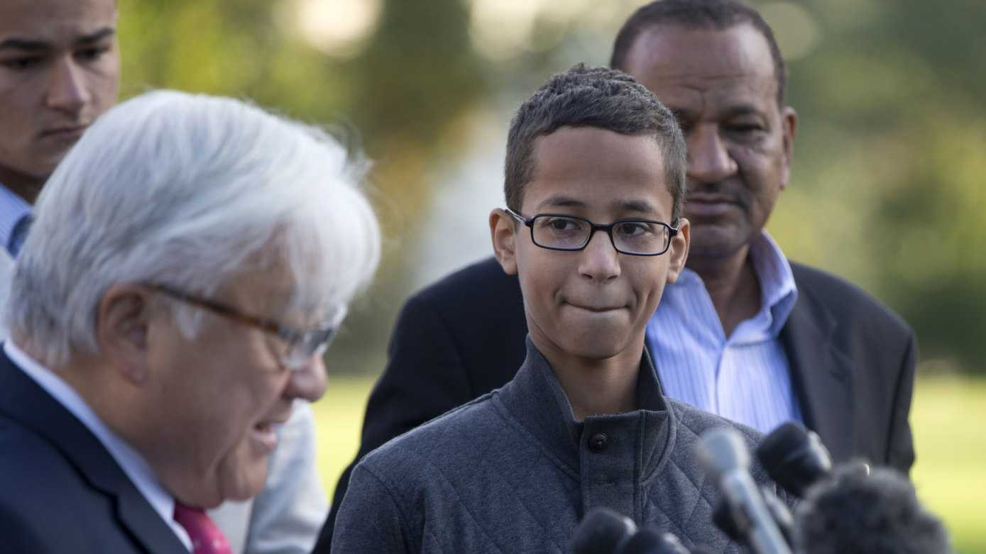 "Ahmed Mohamed, second from right, listens as Rep. Mike Honda, D-Calif., left, speaks during a news conference on Capitol Hill in Washington, Tuesday, Oct. 20, 2015. Mohamed is the 14-year-old ""clock kid"", freshman, who was arrested in Irving, Texas, for bringing an alarm clock science project to his high school teacher. To the far right is Ahmed's uncle Aldean Mohamed."