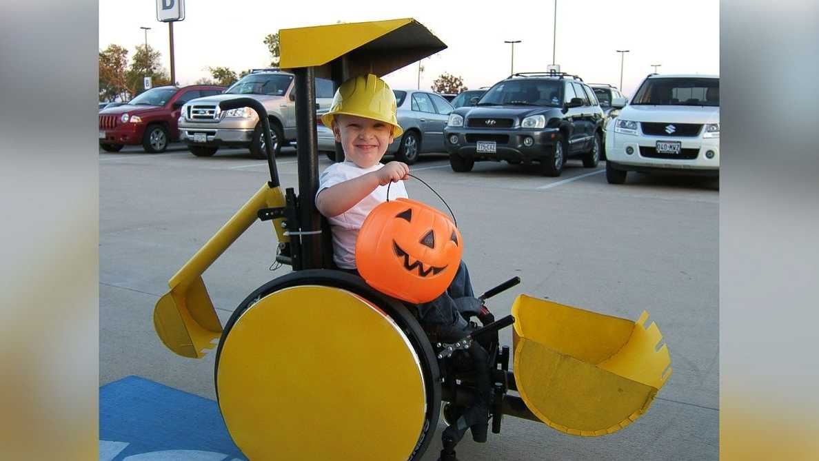 """Caleb McLelland is pictured here at age 3 as """"Bob the Builder"""" in a """"Backhoe/Scoop truck"""" wheelchair costume designed by his mother Cassie McLelland for Halloween 2008."""