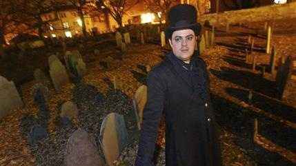 In this Dec. 22, 2003 file photo, Christian Day poses in the Old Burying Ground in Salem, Mass. A judge is scheduled to hear a suit on Wednesday, Oct. 28, 2015, in Salem District Court brought by Lori Sforza, who calls herself a witch priestess, accusing Day, a self-proclaimed warlock, of harassing her online and over the phone for three years. (AP Photo/Lisa Poole, File)
