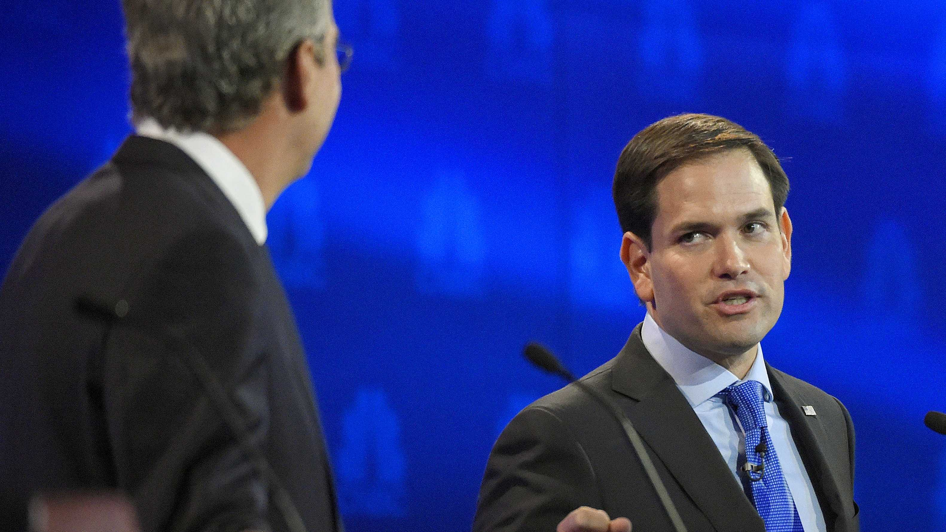 Marco Rubio, right, and Jeb Bush, argue a point during the CNBC Republican presidential debate at the University of Colorado, Wednesday, Oct. 28, 2015, in Boulder, Colo. (AP Photo/Mark J. Terrill)
