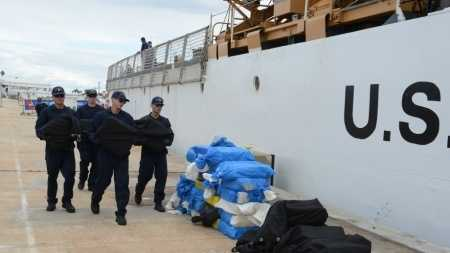 The crew of the Coast Guard Cutter Spencer offload and stack bales of cocaine in St. Petersburg, Fla., Oct. 21, 2015. The crew of Spencer seized approximately $50 million while on patrol in the Caribbean Sea.