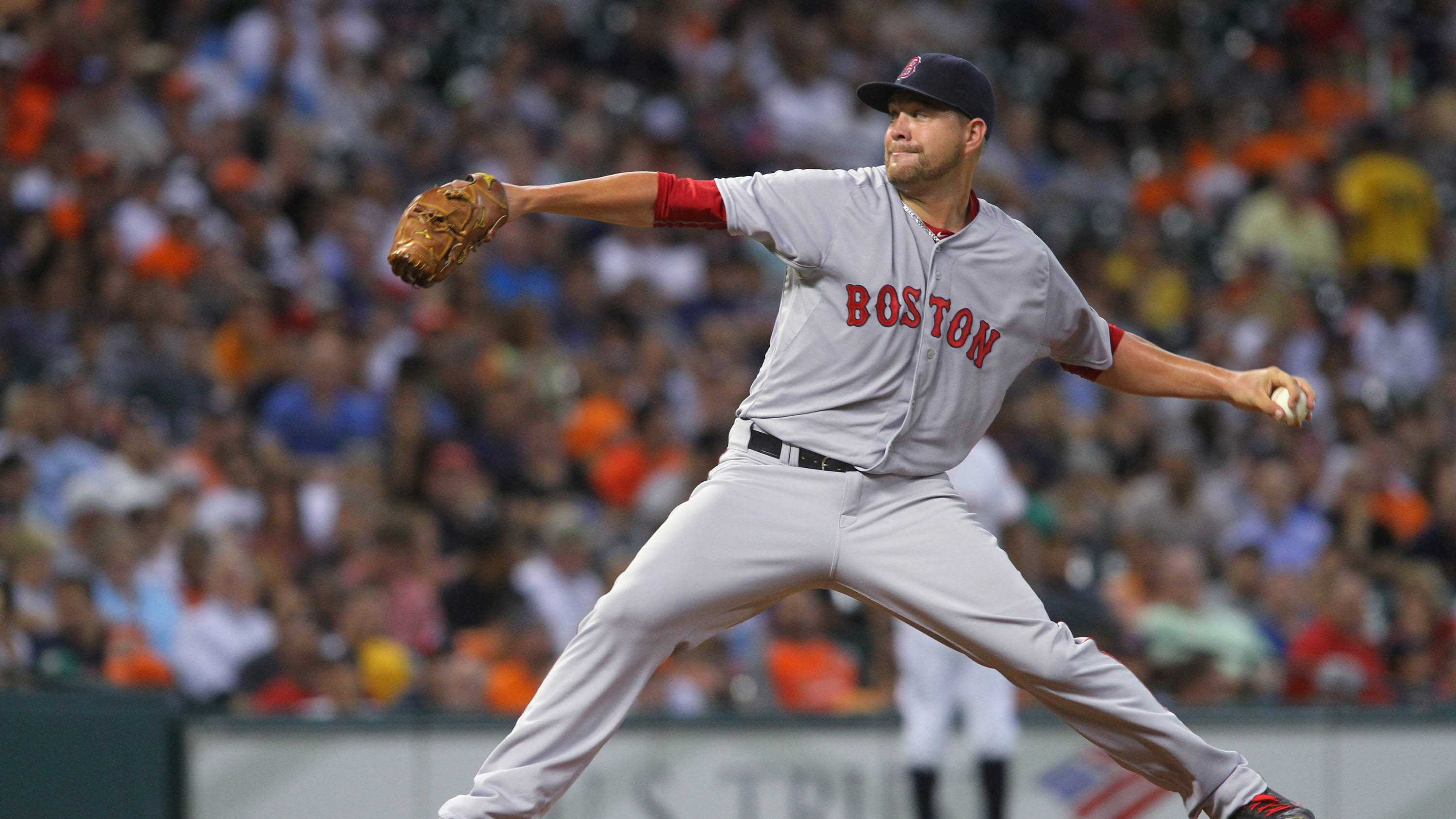 Boston Red Sox's Brian Johnson delivers a pitch against the Houston Astros during the third inning of a baseball game Tuesday, July, 21, 2015 in Houston. (AP Photo/Richard Carson)