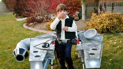 """In this Oct. 27, 2015, photo, provided by Chantelle Bailey, Sebastian Bailey, 5, who has cerebral palsy, stands in his Halloween costume dressed as Han Solo aboard the Millennium Falcon from the original """"Star Wars"""" movies in Sandy, Utah. Sebastian's parents created the costume so that it fits around his walker."""