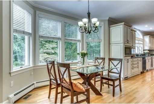 Decorative balconies, rich moldings, stainless Wolf, Sub-Zero and granite Kitchen loaded with antique white cabinetry.
