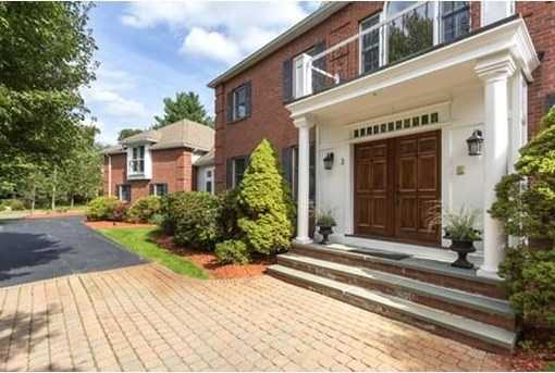 Luxurious, hipped-roof, brick-front mansion in Pheasant Brook Estates!