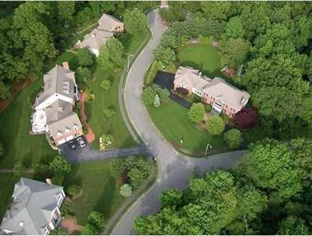 prestigious residence offers curb appeal plus offers one of the most lush and private back yards.