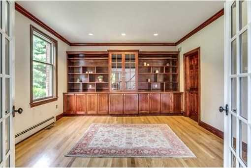 Cherry library, soaring cathedral Family Room and marble Foyer loaded with picture windows.