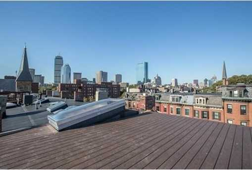 Expansive private roof deck accessed via full staircase & large glass hatch offers gas, water, electricity.