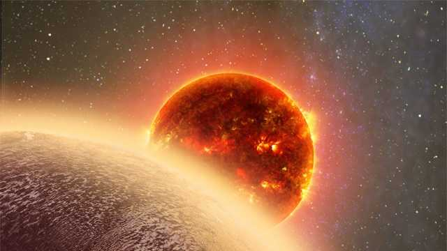 This artist's conception made by Dana Berry of SkyWorks and provided by NASA on Nov. 6, 2015 shows GJ 1132b, foreground, a rocky planet similar to the Earth in size and mass, orbiting a red dwarf star.