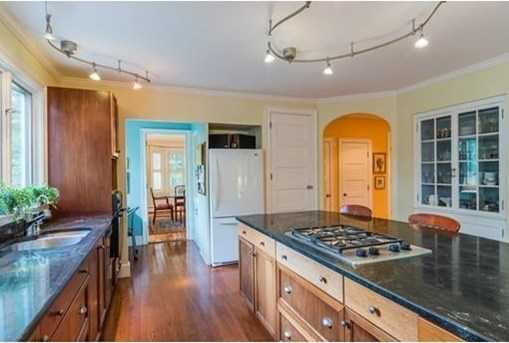 Inviting custom mahogany kitchen with sitting area and large pantry.