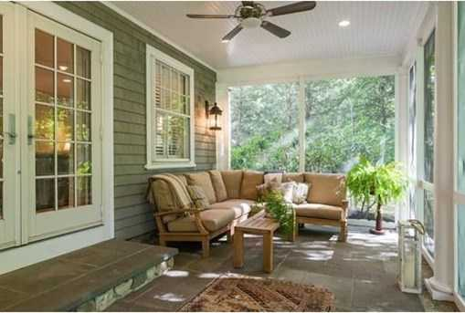 Screened porch showcases breathtaking views of the sweeping meadows