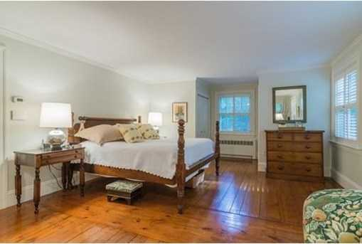 There are five generous bedrooms, including a fireplaced master suite.