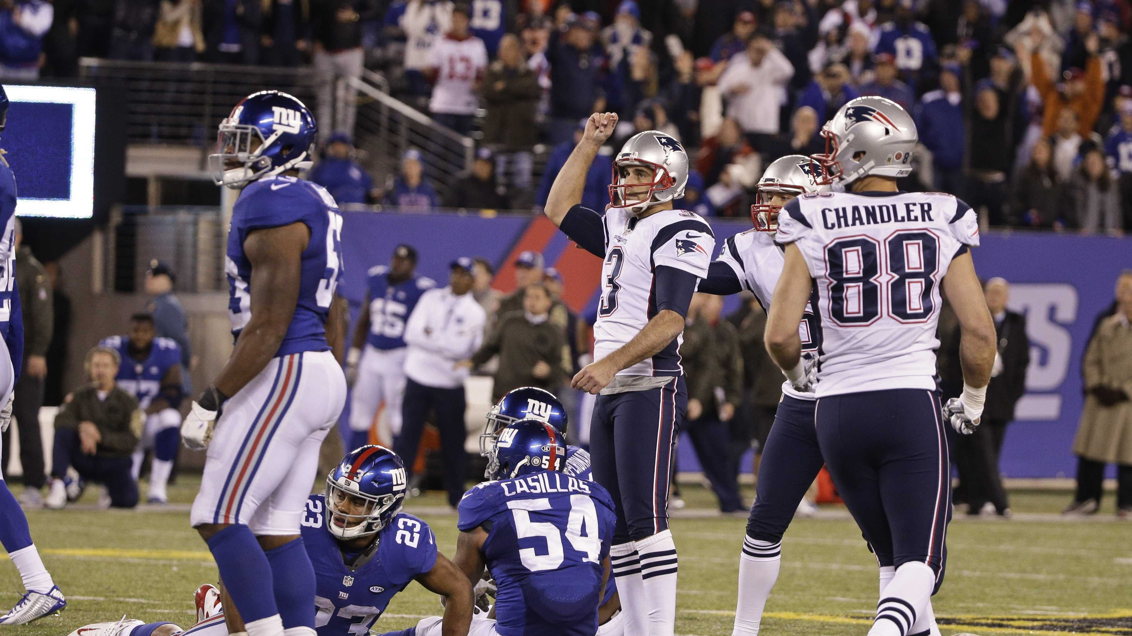 New England Patriots' Stephen Gostkowski (3) celebrates after kicking the game winning field goal as New York Giants' Rashad Jennings (23) and Jonathan Casillas (54) react during the second half of an NFL football game Sunday Nov. 15, 2015, in East Rutherford, N.J. The Patriots won 27-26.