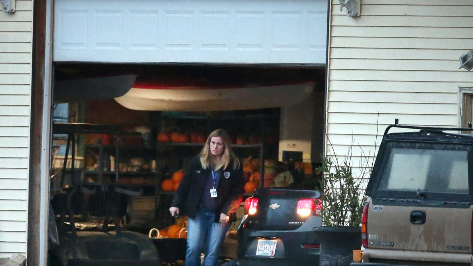 A police car is driven into a garage, Wednesday, Nov. 18, 2015, in Herman, Minn., near where authorities located two teenage sisters from Lakeville who have been missing for more than two years. The girls, Gianna and Samantha Rucki, now 16 and 17 years old respectively, hadn't been seen in public since April 2013 after disappearing in a custody dispute, were found at a horse farm in western Minnesota after police executed a search warrant, Lakeville police Lt. Jason Polinski told the Star Tribune.