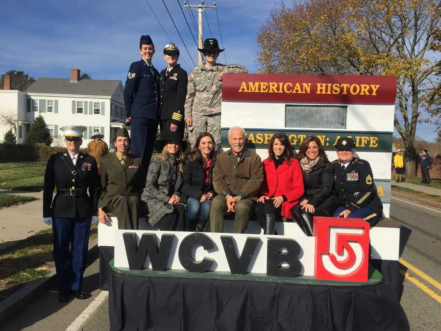 The parade featured decorated floats, like WCVB's, and military marching units, along with re-enactments of every period of American history.