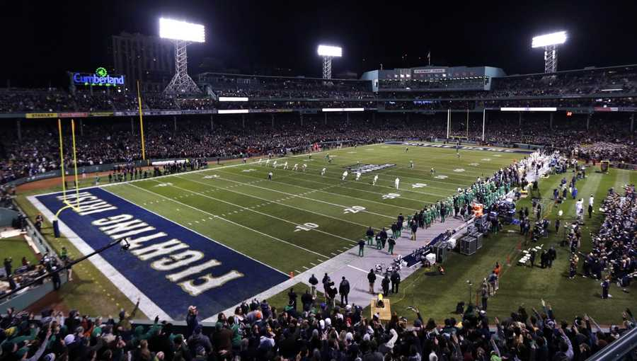 Boston College kicks to Notre Dame on the opening kickoff during the first quarter of the Shamrock Series NCAA college football game at Fenway Park, home of the Boston Red Sox, in Boston Saturday, Nov. 21, 2015.
