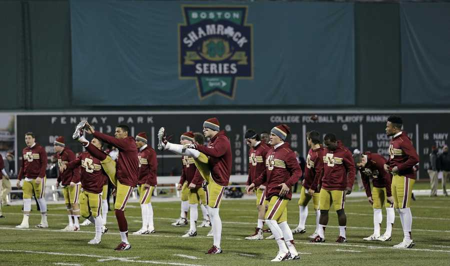Boston College players warm up prior to the Shamrock Series NCAA college football game against Notre Dame at Fenway Park, home of the Boston Red Sox, in Boston Saturday, Nov. 21, 2015.