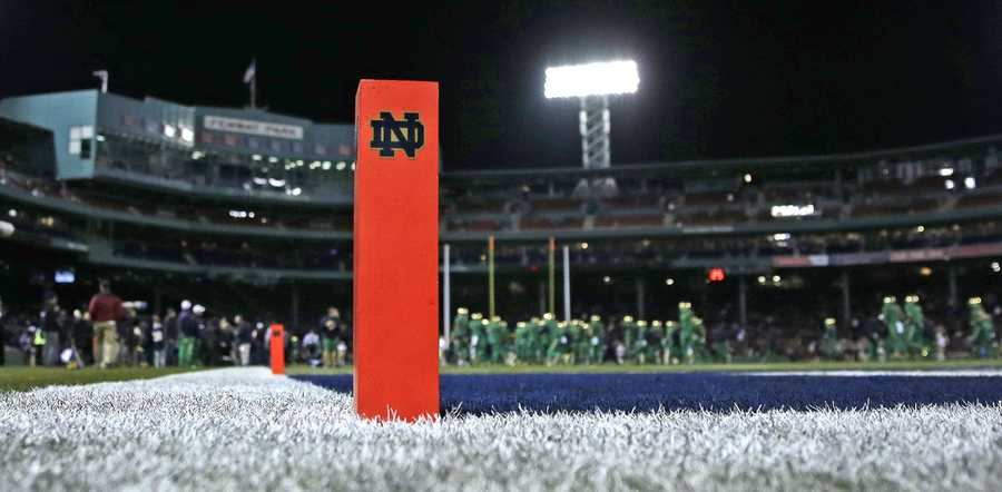 A pylon with a Notre Dame sticker marks the end zone as players warm up prior to the Shamrock Series NCAA college football game at Fenway Park, home of the Boston Red Sox, in Boston Saturday, Nov. 21, 2015. Notre Dame hosts Boston College in the game.
