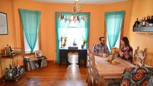 Marcus Ohanesian and Katie O'Connor in their Worcester apartment that they list on Airbnb.