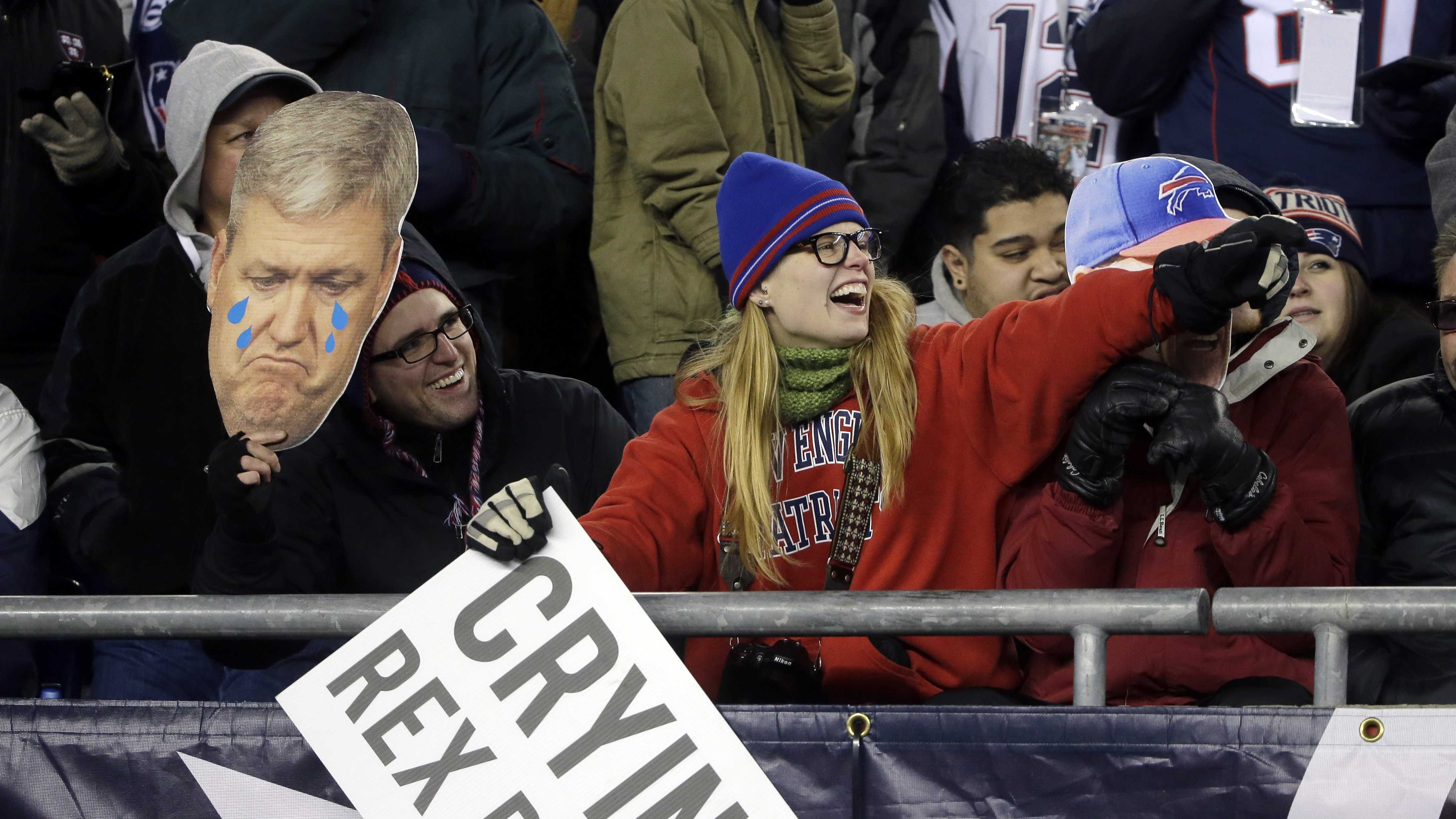 New England Patriots fans hold signs and photos referring to Buffalo Bills head coach Rex Ryan in the first half of an NFL football game Monday, Nov. 23, 2015, in Foxborough, Mass. (AP Photo/Steven Senne)