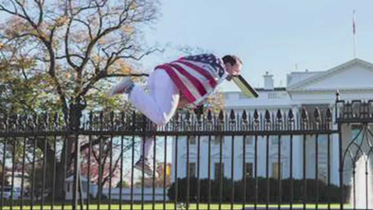 A man draped in an American flag climbed over the fence at the White House on Thursday, prompting a lockdown as the first family celebrated Thanksgiving.