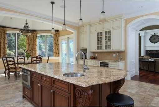 STUNNING gourmet chefs kitchen replete w/STATE-OF-THE-ART appliances,walk-in pantry& so much more..
