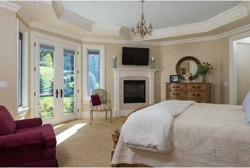 GRAND MASTER FIREPLACED SUITE boasts his and her SPA-LIKE master baths.