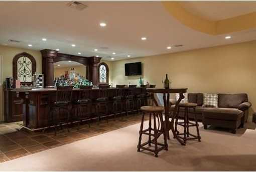 Entertainment room w/full bar, guest room w/ full bath COMPLETES THIS BREATHTAKING HOME