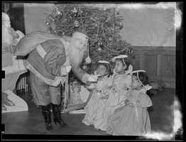 1934-1956 (approximate): Father Christmas and 3 angels
