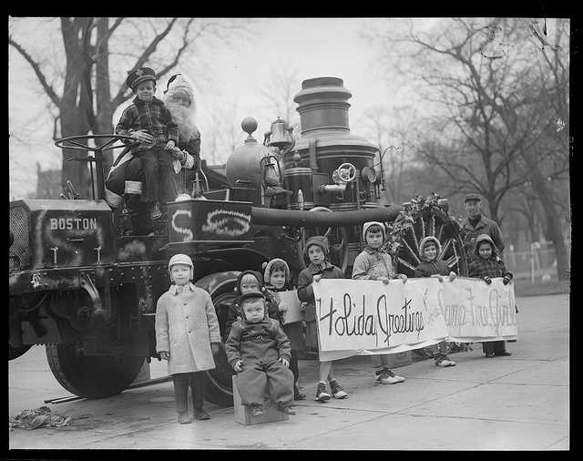 1940-1949 (approximate): Santa and the Campfire Girls wish Boston a merry Christmas at Boston Common.