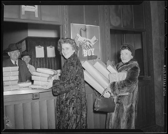 1942: Ladies deliver package at South Station postal annex during Christmas rush.