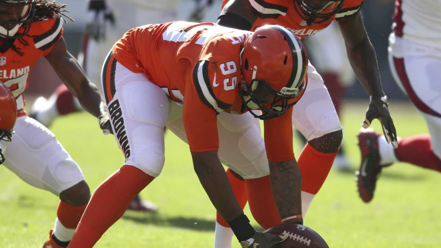 Cleveland Browns defensive end Armonty Bryant (95) recovers a fumble by Arizona Cardinals running back Chris Johnson (23) in the first half of an NFL football game in Cleveland.
