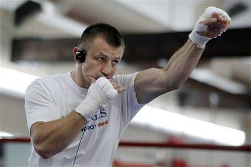 Polish heavyweight boxer Tomasz Adamek wears headphones as he works out at the World Boxing and Fitness Center in Jersey City, N.J., Thursday, August 23, 2012. Adamek will fight Travis Walker September 8, 2012, at Newark's Prudential Center.